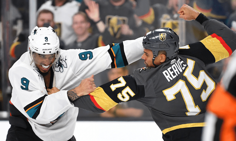 Evander Kane of the San Jose Sharks and Ryan Reaves of the Vegas Golden Knights